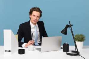 sales manager sitting at his desk